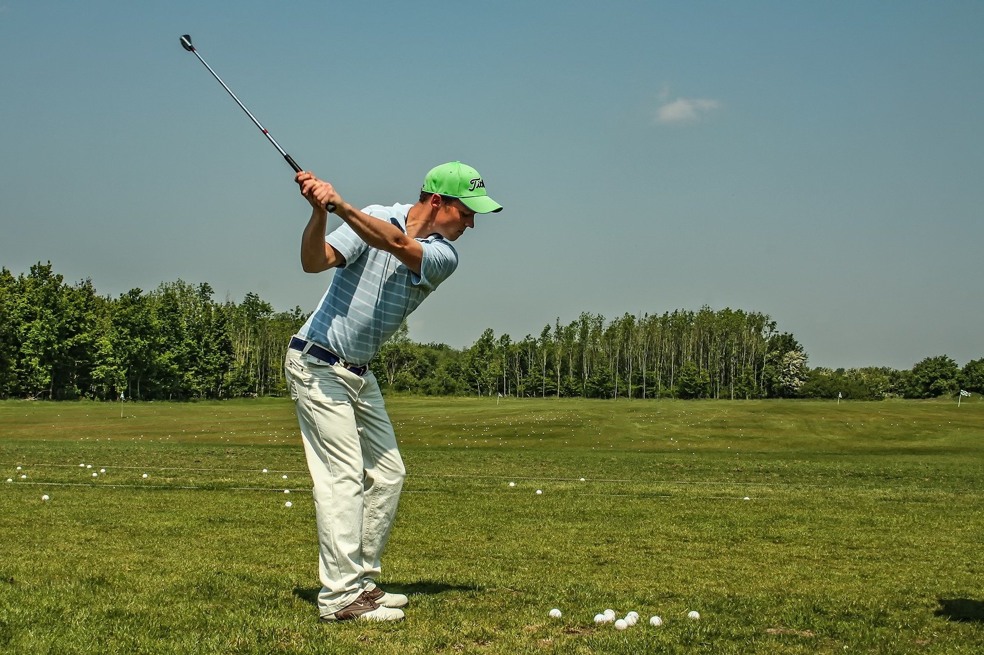 golfer using performance enhancement skills by making practice more game like to improve his performance on the golf course